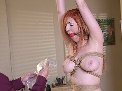 Long haired Lauren Phillips ass fucked with her hands tied up