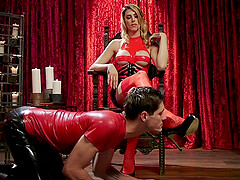 Shemale in a latex outfit Casey Kisses doggy fucks a mature guy