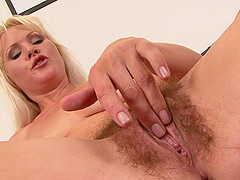 Bombshell blonde MILF Kathy Anderson rides cock and gives head