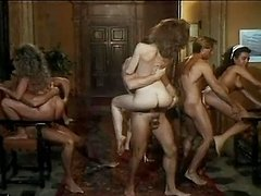 Retro video of an amazing orgy with hot babes getting ass fucked