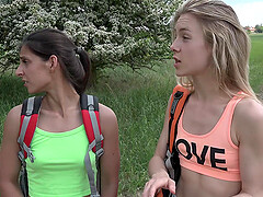 After walking Angela Allison and her girlfriend enjoy sex in nature