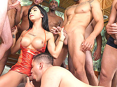 Twelve hung guys are around poor transsexual babe Yasmin Dornelles.
