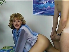 Horny German milf checks a boy and fucks him
